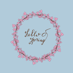 Hello Spring hand drawn lettering with sacura wreath. Vector greeting card on a blue background.