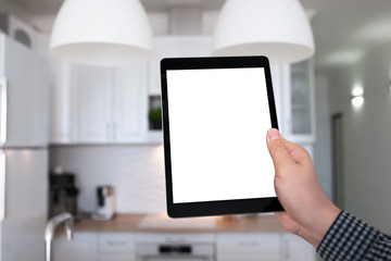 male hand holding tablet with isolated screen kitchen in house