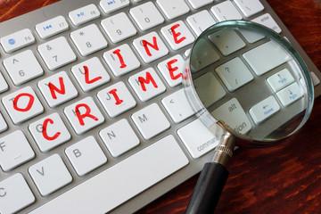 Online crime written on a keyboard.