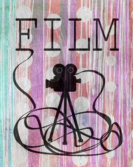 movie camera illustration on wood grain texture