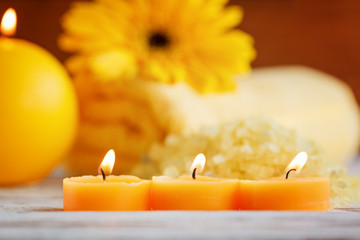 Closeup yellow little candles. Spa products setting