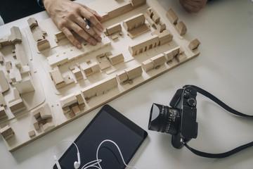 Urban development model, tablet and camera