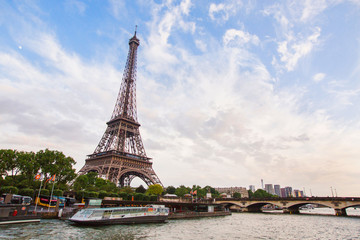 Walk on the ship on the river Seine in Paris. Travel through Europe. Eiffel Tower against the sky in Paris. Attractions in France.