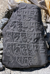 Ancient stone carved with the buddhist mantras near Dingboche - Nepal, Himalayas