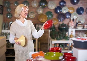 woman buying ceramic ware