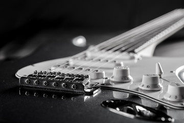 narrow cut of an electric guitar in black and white