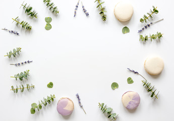 Macaroons and eucalyptus on woman table top view mock up