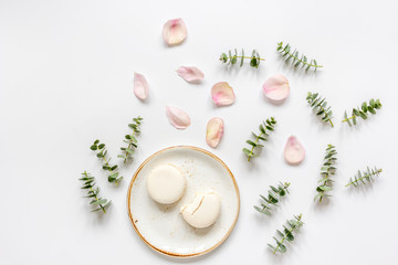 woman table design with flower and macaroons in soft light top view