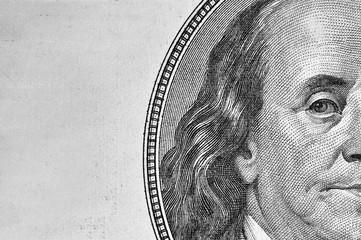 Benjamin Franklin's portrait on 100 dollar bill.