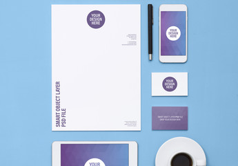 Tablet and Smartphone with Stationery on Blue Surface Mockup