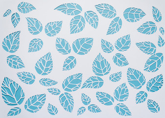 white, blue background leaves. leaves cut from paper
