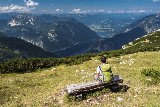 A man relaxing on the bench in Alps, Dachstein mountain.