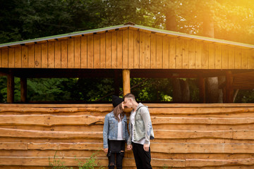Couple in casual denim clothing kissing outdoor