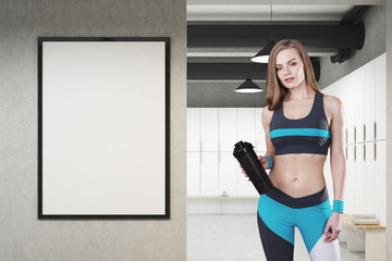 Girl in locker room with framed poster, front