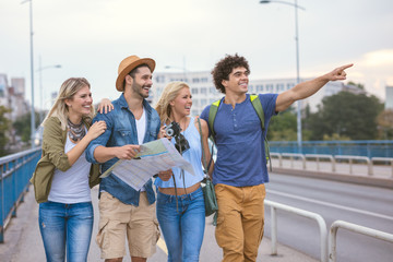 Group of happy hungry young people searching for good restaurant.