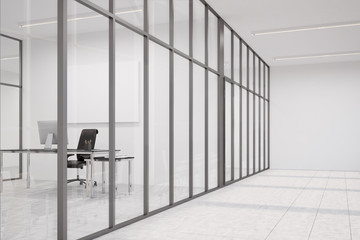 Office lobby with glass walls and CEO office