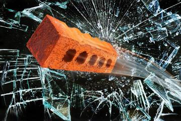 Brick through Window.