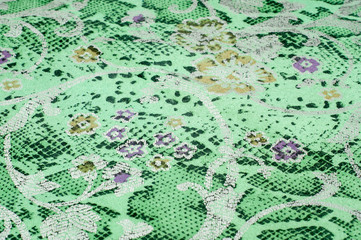 The skin texture, green color patterned