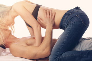 Couple kissing in bed. Love, Sex, Foreplay concept