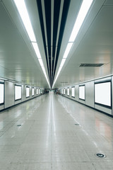modern hallway of airport or subway station with blank billboards on wall,Hong Kong,china.