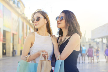 Fashionable girls doing shopping