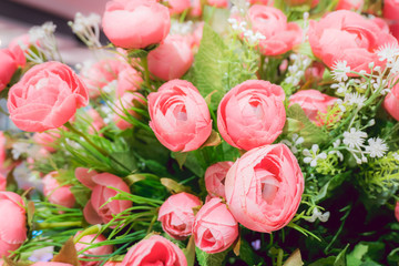 Rose-pink flowers decorate in basket, furnished house with beautiful flowers.
