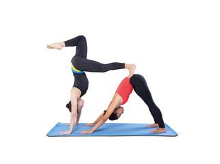 Two beautiful women doing yoga asana double isolated on white background.