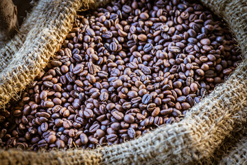Closeup of coffee beans with sunlight in gunny bag