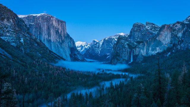 Panorama of Yosemite Valley with Fog and Waterfall Under the Blue Hour Moonlight