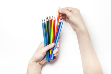 woman hand hold a color pencil isolated white