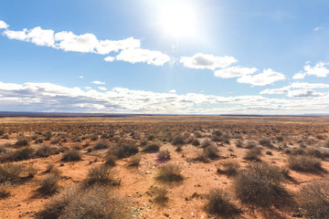 Remote desert landscape under bright sun