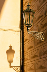 golden light creating shadows on building exteriors/interiors and objects