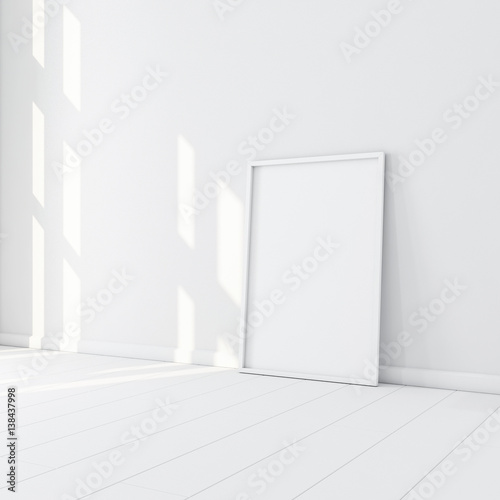 White Frame with Poster Mockup standing on the floor in empty room ...