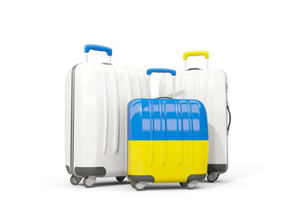 Luggage with flag of ukraine. Three bags isolated on white