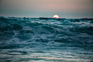 Sun is going down in ocean