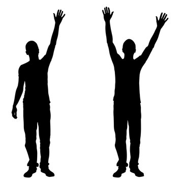 Silhouettes of people with hands in the air isolated on white