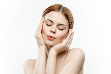 beautiful woman with closed eyes and hands near face