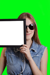 Sign woman holding showing white blank paper placard. Smiling happy young Isolated on green screen chroma key background.