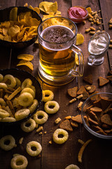 Beer and snacks on the wooden background