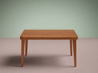 Empty wooden table in the room