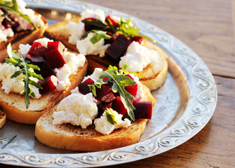 Bruschetta with beet, feta and ruccola
