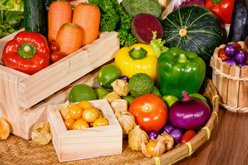 Arrangement various fresh fruits and vegetables in wooden container