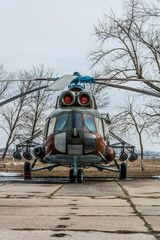 Military helicopter in airfield