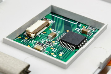 Circuit board with installed electronic components in the housing
