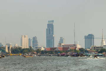 The city of Bangkok with skyscrapers seen from Chao Phraya river, Bangkok, Thailand