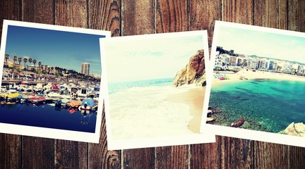Vintage photos from summer holiday with traditional white frame placed on wooden desk.