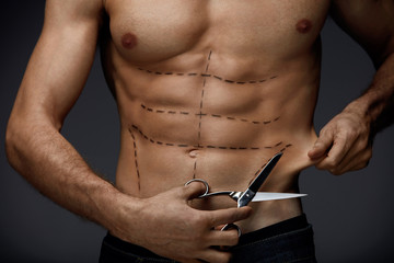 Sexy Hot Male Body With Surgical Lines And Scissors In Hand