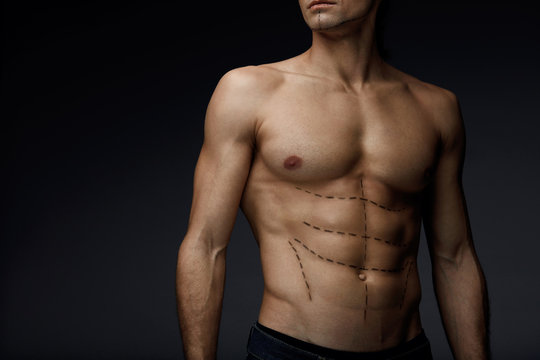 Closeup Of Man With Sexy Fit Body And Black Lines On Skin
