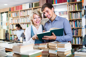 woman and man having books