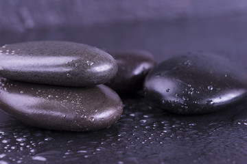 black stones covered by rain drops